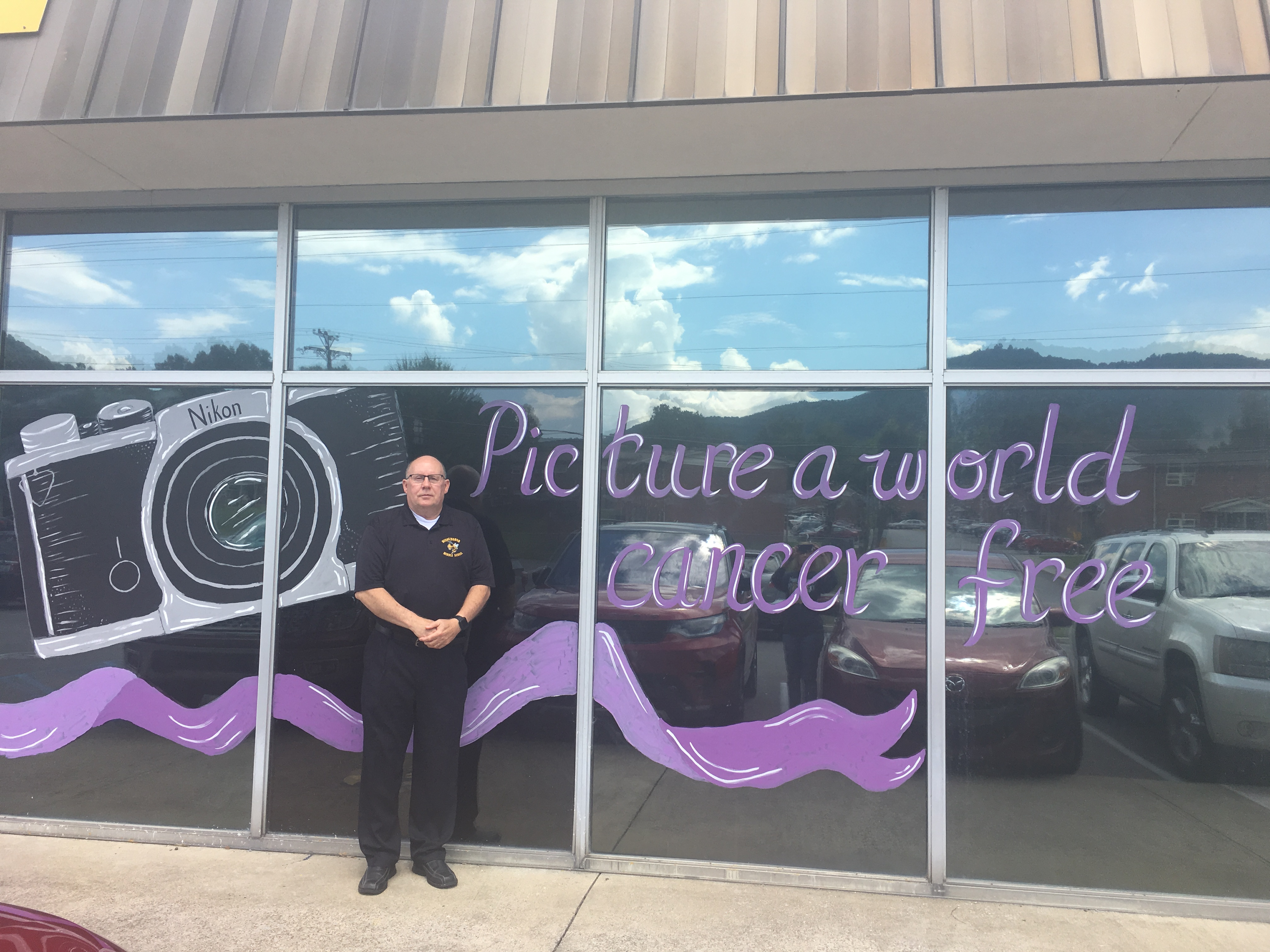 Principal Bill Jones with Relay for Life Window